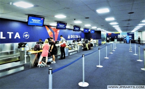 Delta Airlines Passengers Check In Desks at JFK Airport, New York, USA