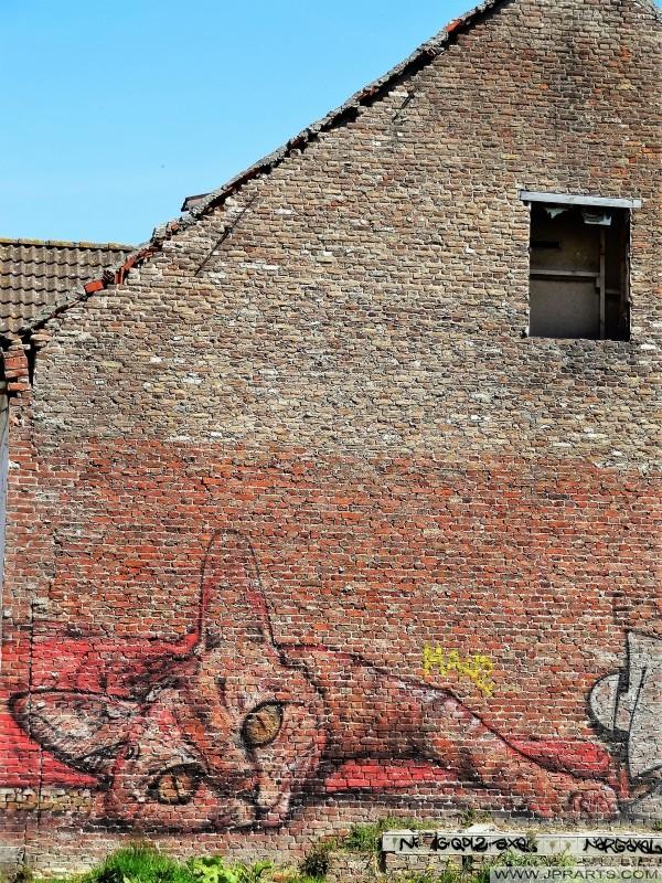 Graffiti von einer Katze in Doel, Belgien