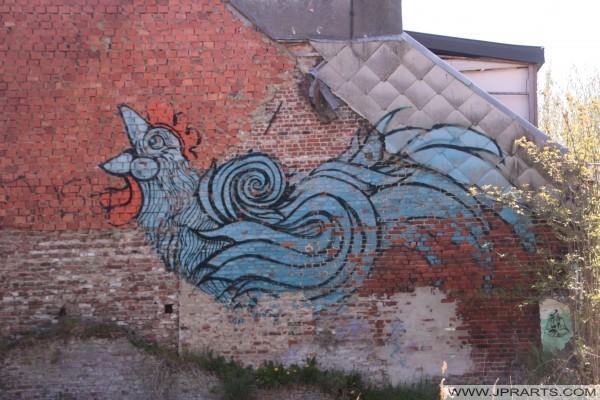 Graffiti van een haan in Doel, Belgie