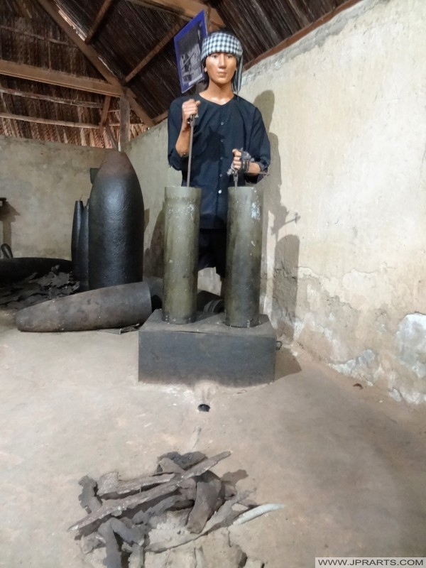 Viet Cong dummy re-using unexploded American munitions (Củ Chi Tunnel, Ben Dinh, Vietnam)