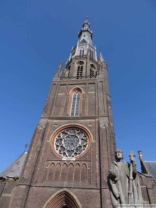 Church Tower of St. Boniface Church and the Christ the King Statue in Leeuwarden, Netherlands