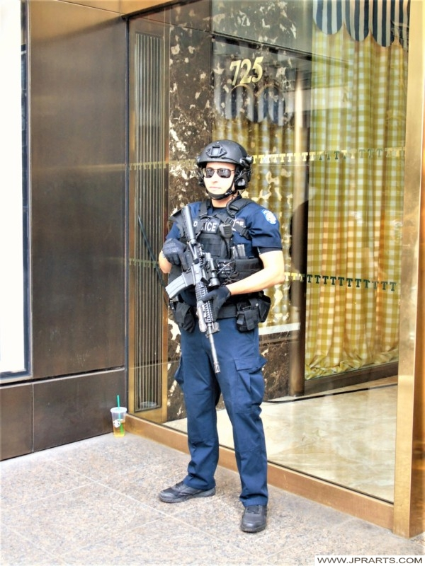 Security Guard with Heavy Weapons, including Machine gun, outside the Trump Tower (New York, USA)