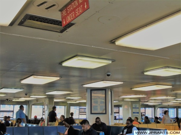 People sitting inside of the Staten Island Ferry (New York, USA)